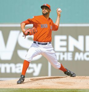 BOSTON RED SOX starting pitcher David Price throws to the Minnesota Twins during a spring training baseball game in Fort Myers, Fla. on Thursday. Price gave up consecutive homers in the middle inning of his debut, and the Twins knocked off the Red Sox, 8-2.