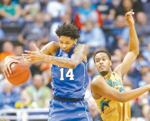 DUKE GUARD Brandon Ingram (14) gathers in a rebound in front of Notre Dame forward V.J. Beachem (3) during the second half of an NCAA college basketball game in the Atlantic Coast Conference tournament, in Washington on Thursday.