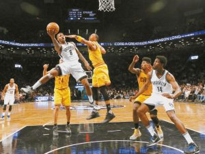 CLEVELAND CAVALIERS forward Channing Frye (9) defends Brooklyn Nets guard Sean Kilpatrick (6) in the first half of an NBA basketball game on Thursday, in New York. The Nets beat the Cavaliers 104-95.