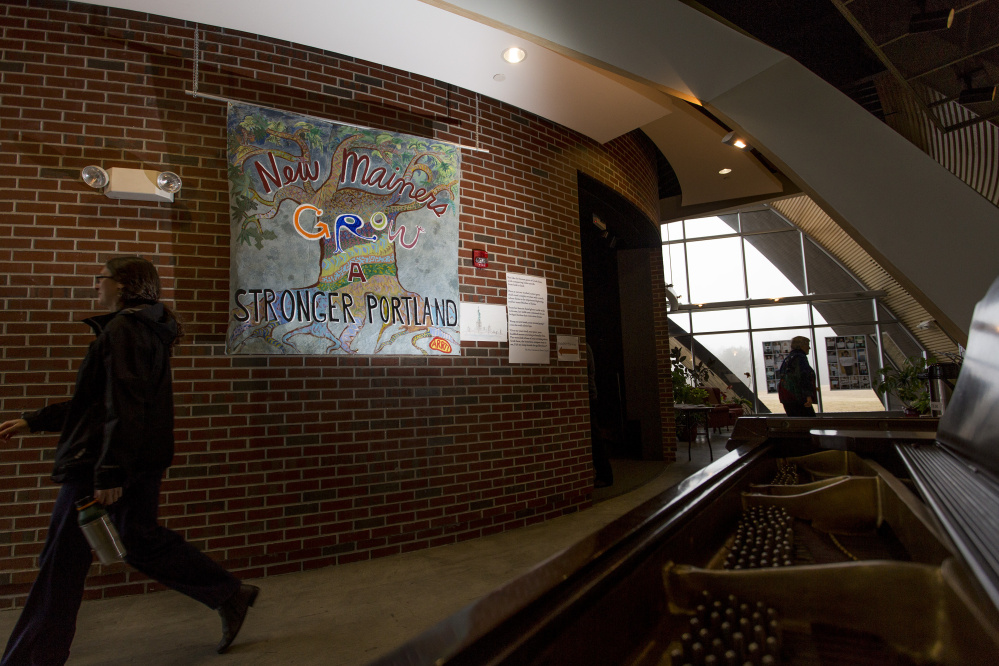 """A poster here, seen in the main hallway reads """" New Mainers Grow a Stronger Portland."""" Gabe Souza/Staff Photographer"""