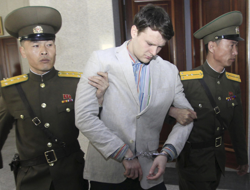 American student Otto Warmbier  is escorted at the Supreme Court in Pyongyang, North Korea, on March 16, 2016.