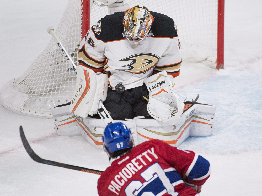 Ducks goalie John Gibson makes a save on a shot by Montreal's Max Pacioretty in the first period Tuesday night in Montreal. The Canadiens won, 4-3.