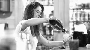 JEN SHAUL, a bartender at Buck's Saloon in Melba, Idaho, pours whiskey at the bar.