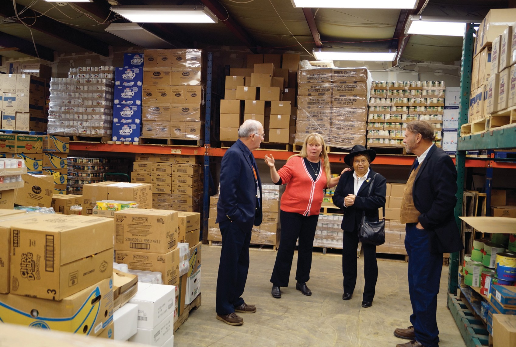 Jodi Bissonnette, second from left, conducts a tour of Food Rescue of York County in Alfred during an open house in November 2013, when the agency moved into the then-new quarters donated by York County government. The agency abruptly closed last week.