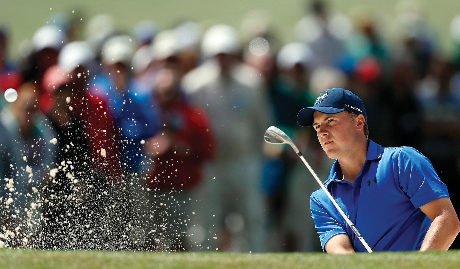 Jordan Spieth hits from a bunker on the seventh hole during the second round of the Masters Friday in Augusta, Ga.