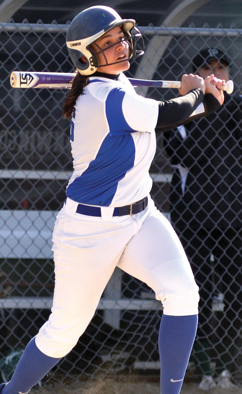 UNE's Abby Lambert Makes contact in the fourth inning Wednesday afternoon.