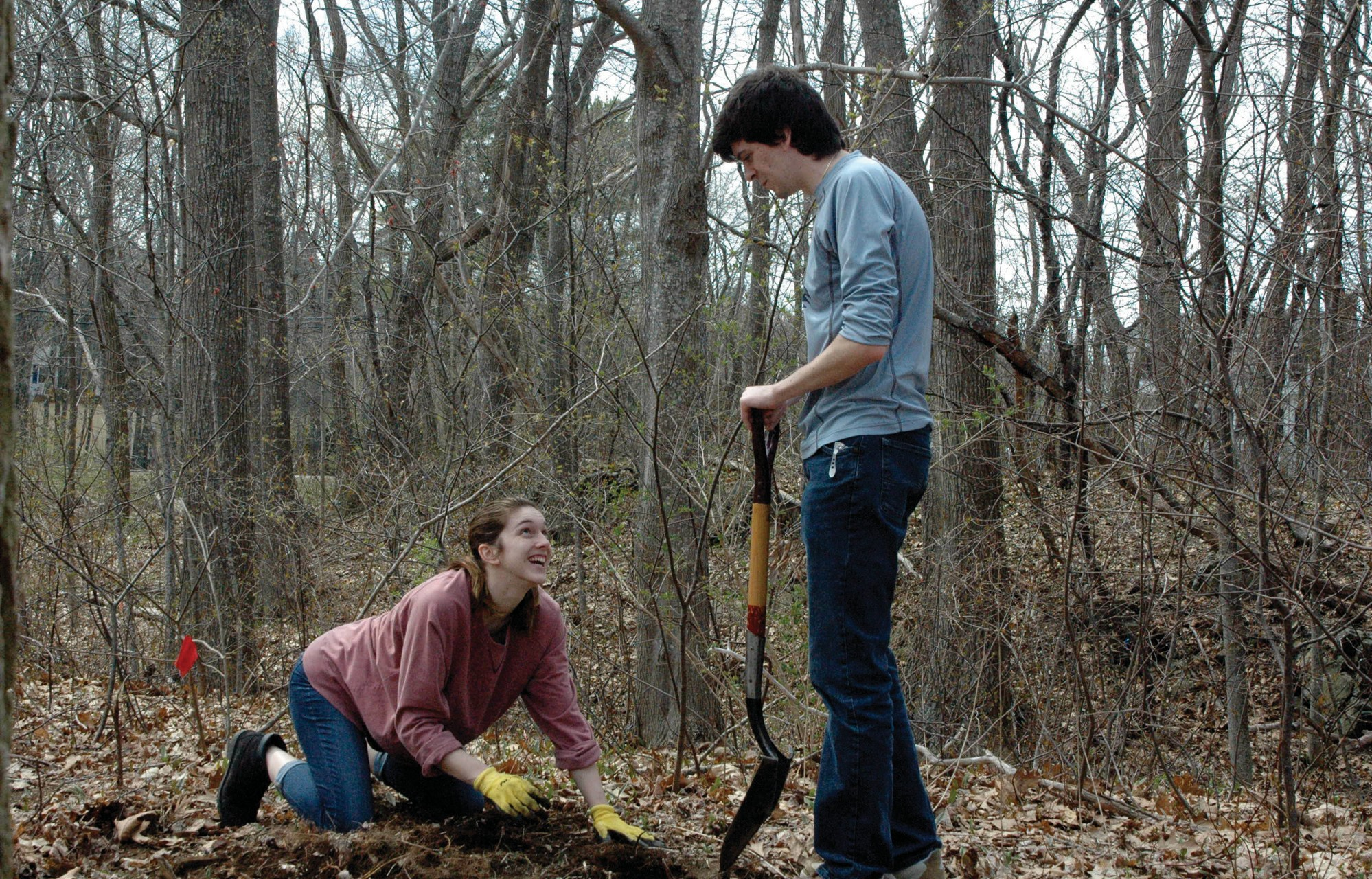 University of New England students Nicole Belknap and Ryan Roseen dig a hole in the dirt on the Biddeford campus on Friday afternoon during an American chestnut tree planting project in celebration of Earth Day.