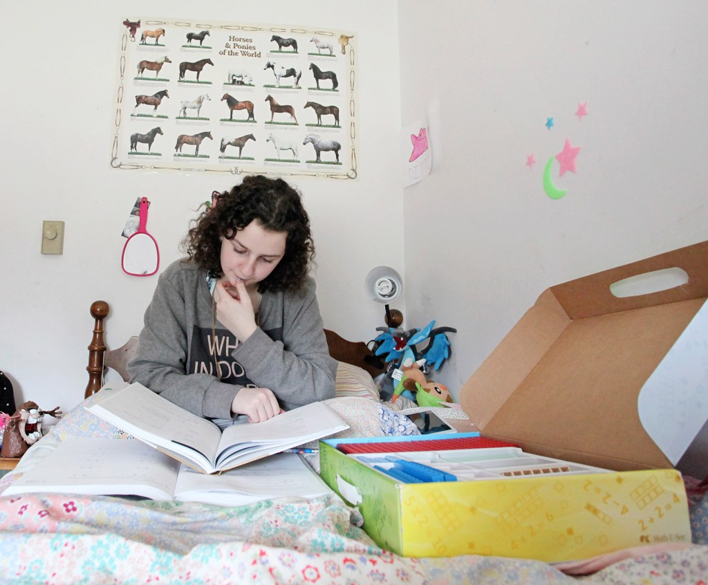Emma Verrill, 14, studies math in her bedroom in North Yarmouth.