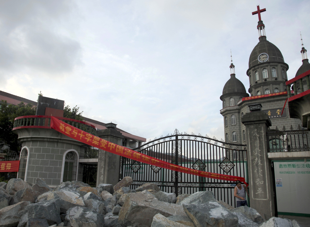 Members of a Christian church in Zengshan Village  piled up rocks at the front gate to prevent government workers demolishing their church's  cross in 2014. China has long had an uneasy relationship with Christianity, with the crosses targeted for building code violations.