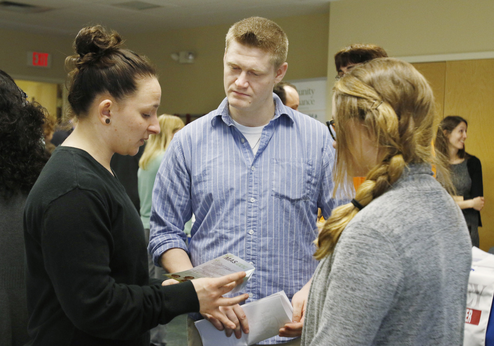 Donald James, an ex-worker at Merrymeeting Behavioral Health Services, talks with Erica Higginbotham, left, and Brooke Dunham about jobs at MAS Community Health.