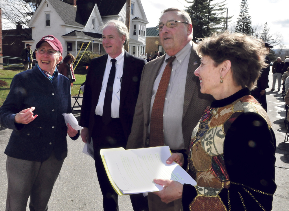 Former University of Maine at Farmington President Theodora Kalikow, left, looks back at the Theodore Kalikow Education Center building, which was dedicated on Tuesday. Beside Kalikow, before Tuesday's event, are university Chancellor James Page, Gov. Paul LePage and UMF President Kathryn Foster.
