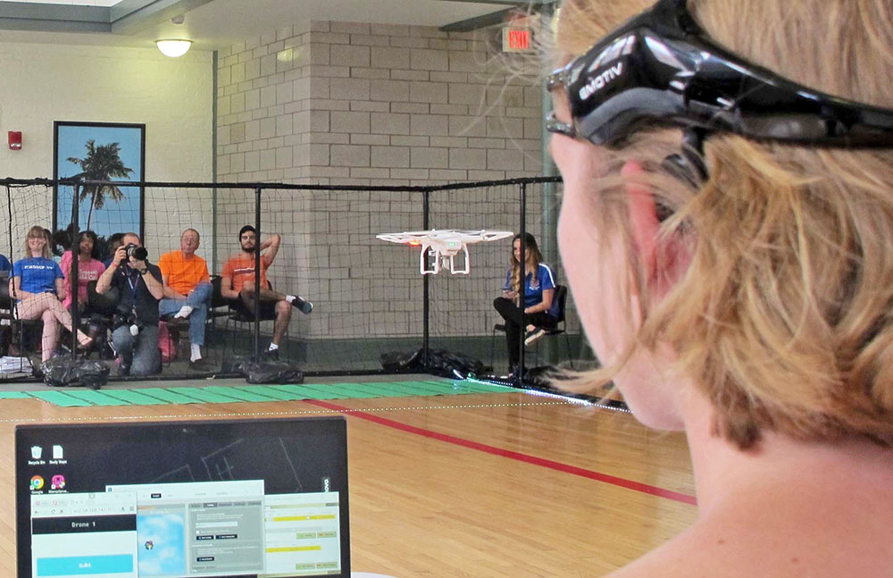 A University of Florida student uses a brain-controlled interface headset to fly a drone during a mind-controlled drone race in Gainesville, Fla. The Associated Press