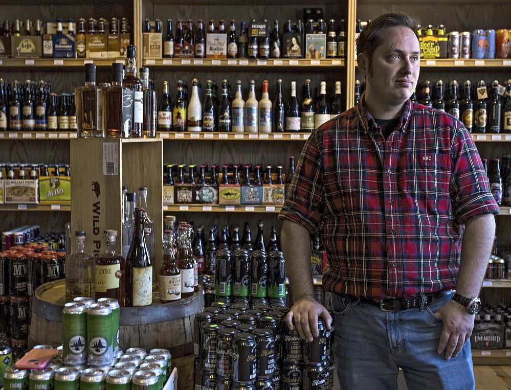 Kevin Casey of Old Port Spirits & Cigars on Commercial Street in Portland has partnered with Boston-based Drizly, which connects the retailer to customers online.