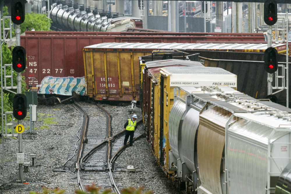Several cars remain overturned after a CSX freight train derailed in Washington on Sunday near a Metro stop in Washington, D.C.