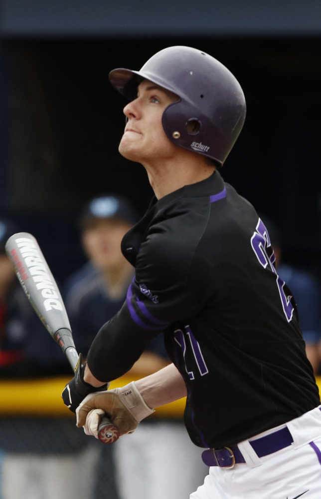 Orey Dutton of Deering watches the flight of the ball during the first inning of the game at Westbrook. Pitchers James Sinclair and Colby Dame of Deering combined to shut the Blue Blazes down, giving up a total of four hits.