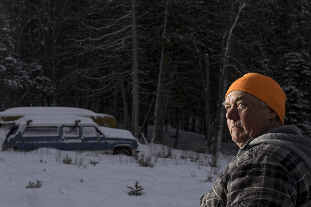 Carter McBreairty stands outside his Allagash home near dusk. Unaware that a visitor to the area was an undercover agent, McBreairty allowed the man who was investigating him to stay in his house for days, even when McBreairty was at his construction job in midcoast Maine.