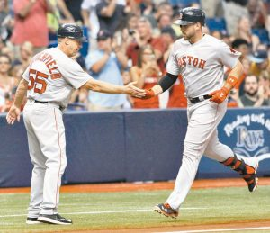 BOSTON RED SOX third base coach Brian Butterfield (55) congratulates Travis Shaw, right, after his solo home run off Tampa Bay Rays starter Chris Archer during the second inning of a baseball game on Tuesday in St. Petersburg, Fla.