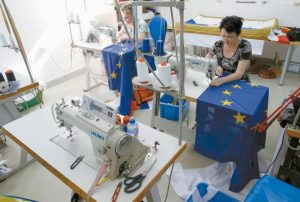 SEAMSTRESSES SEW EU FLAGS in a workshop in Belgrade, Serbia, Wednesday. Serbia, Montenegro, Macedonia, Bosnia, Kosovo and Albania, all at different stages in joining the EU, have declared that the British exit in a referendum last week will not diminish their membership efforts.