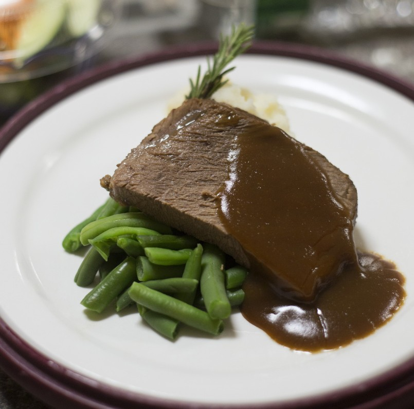 Pot roast with gravy, green beans and mashed potatoes and Central Maine Medical Center in Lewiston.