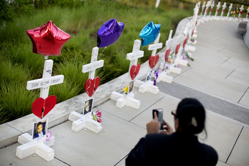Crosses, one for each victim, line a walkway a few blocks from Pulse, the nightclub where a gunman killed 49 people Sunday morning. Experts say it's too soon to gauge whether a week of horrific news out of Orlando will hurt tourism there.