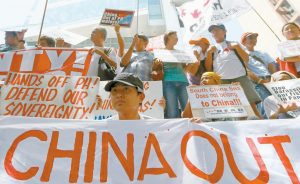 PROTESTERS display their message during a rally outside of the Chinese Consulate hours before the Hague-based UN international arbitration tribunal is to announce its ruling on South China Sea today in Makati city east of Manila, Philippines. The protesters are urging China to respect the Philippines' rights over its exclusive economic zone and extended continental shelf as mandated by the UN Convention of the Law of the Sea or UNCLOS.