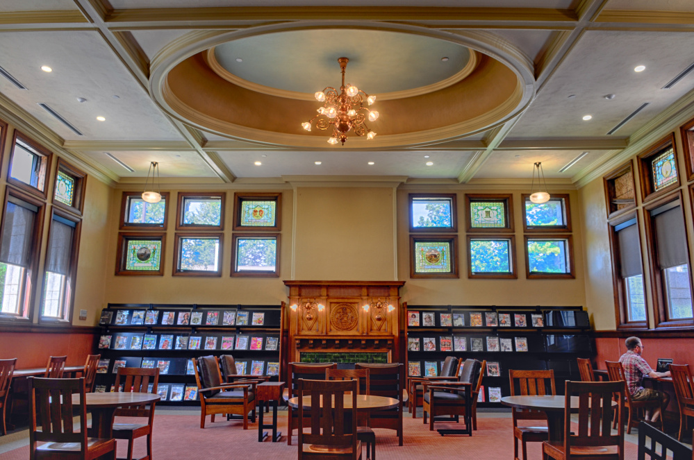 This stacks room as it appeared Tuesday, after renovation, at Lithgow Public Library in Augusta. The rest of the stained glass windows will be reinstalled after they're done being repaired, but the painting over fireplace is not returning.