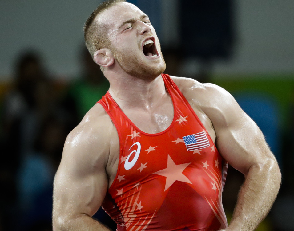Kyle Snyder of the U.S. celebrates after winning his semifinal match in the 97-kilogram freestyle wrestling division on his way to a gold medal.
