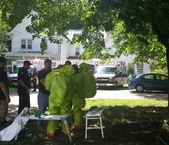 Members of the Waterville Fire Department donned hazmat suits to respond after a resident overused bug spray Thursday afternoon at an apartment on upper Main Street.