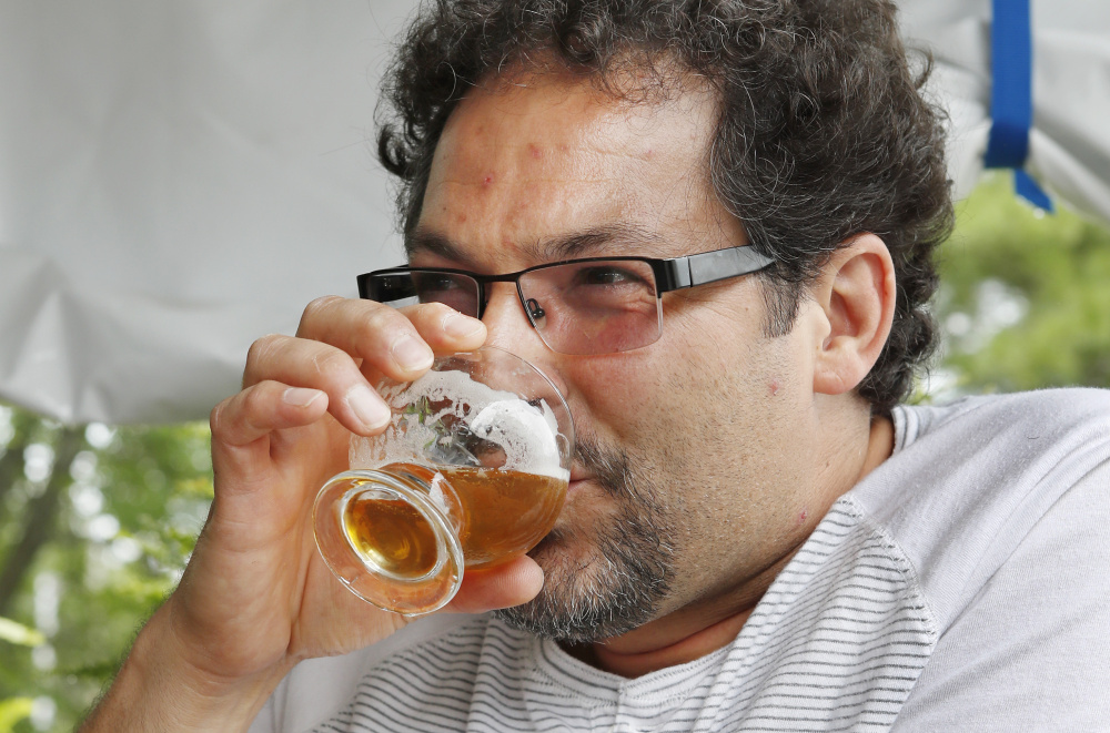 Joe Mondo of Frederick, Maryland, samples a beer at the Maine Beer Co. on Monday.