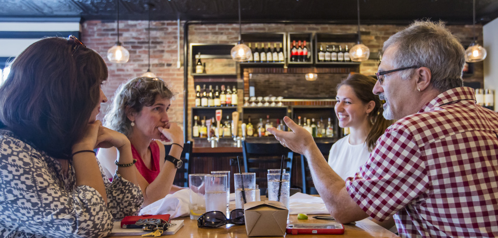 A group that is designing a food studies program for USM discusses plans over lunch at Isa Bistro on Portland Street. The effort is under the direction of Michael Hillard, right, and includes, from left, Mary-Elizabeth Simms, Jo D. Saffeir and Ali Mediate.