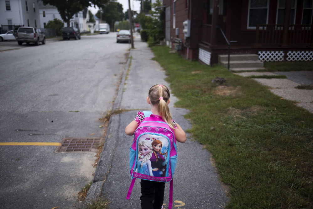 Arianna walks to school for her first day of kindergarten.