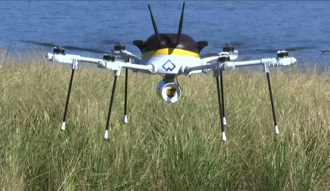 A test drone making a UPS delivery lands on Children's Island in Marblehead, Mass., on Thursday.