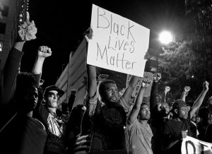 PROTESTERS stand in unity as they prepare to march throughout the city of Charlotte to protest Tuesday's fatal police shooting of Keith Lamont Scott, in Charlotte, North Carolina, Friday. After darkness fell, dozens of people carried signs and chanted to urge police to release dashboard and body camera video that could show more clearly what happened.