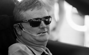 INDY RACING LEAGUE DRIVER SAM SCHMIDT prepares to drive his modified Corvette on Tuesday in Las Vegas. Schmidt was paralyzed from the neck down in a crash 16 years ago. His car uses four cameras to monitor his head and transmit his movements to the tires. He breathes into a tube to accelerate and sucks the air out when he wants to brake.