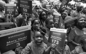 """YOUNG GIRLS known as Chibok Ambassadors, carry placards bearing the names of the girls kidnapped from the government secondary school in Chibok, two years ago, during a demonstration, in Abuja, Nigeria. Nigerian President Muhammadu Buhari is inviting the United Nations to help negotiations to swap the kidnapped schoolgirls from Chibok for detained leaders of the Boko Haram Islamic extremist group. A government statement said Buhari's offer is a """"show of commitment"""" made to U.N. Secretary General Ban Ki-moon Wednesday on the sidelines of the U.N. General Assembly in New York."""