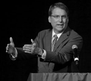 NORTH CAROLINA Gov. Pat McCrory speaks during a candidate forum in Charlotte, North Carolina, on June 24. The NCAA and ACC delivered the latest blows this week, stripping the state of its lucrative championships and leaving the Republican with another deep bruise as he fights for his political life. Entering the final weeks of the nation's most closely watched governor's race, McCrory is trying to reset the focus for voters.
