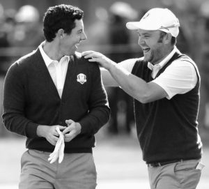 EUROPE'S Andy Sullivan congratulates Europe's Rory McIlroy after McIlroy holed his approach shot on the sixth hole during a practice round for the Ryder Cup golf tournament on Thursday at Hazeltine National Golf Club in Chaska, Minn.
