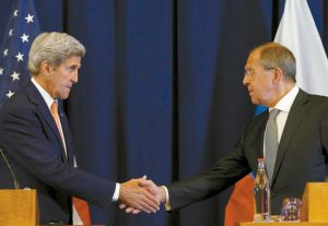 U.S. SECRETARY OF STATE JOHN KERRY, left, and Russian Foreign Minister Sergei Lavrov shakes hands at the conclusion of a news conference following their meeting to discuss the crisis in Syria, in Geneva, Switzerland. The deal crafted by the U.S. and Russia to halt the Syrian civil war and focus efforts on rooting out extremists in the country is rife with legal and liability questions that are fueling Pentagon skepticism about military cooperation between the two powers, senior U.S. officials said.