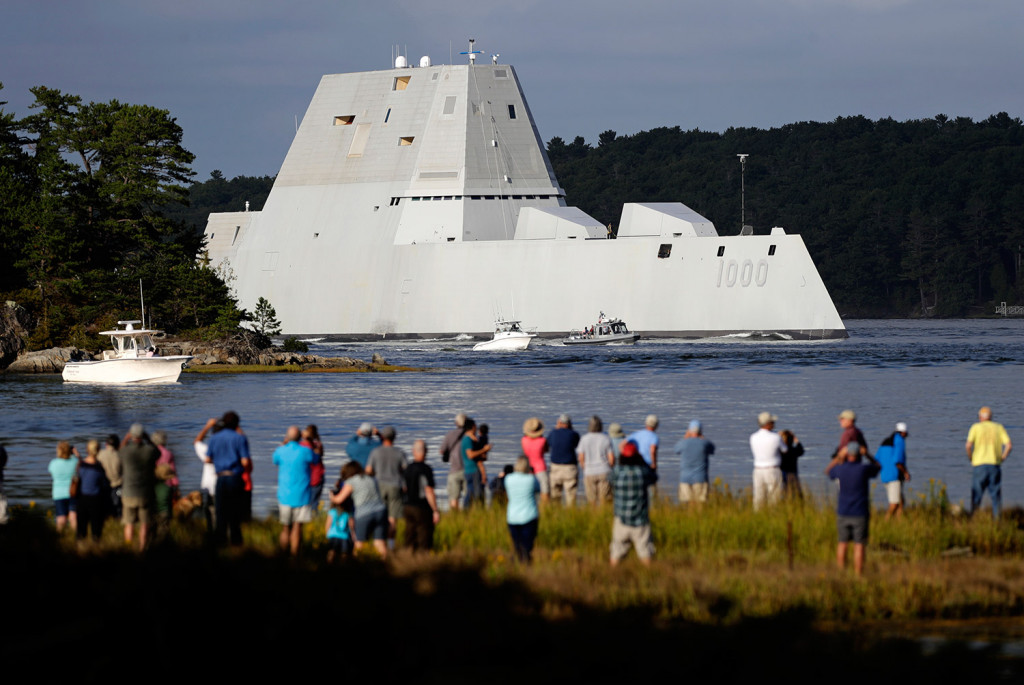 The Zumwalt is an imposing sight as it heads down the Kennebec River from Bath Iron Works on Wednesday, drawing spectators along the way.