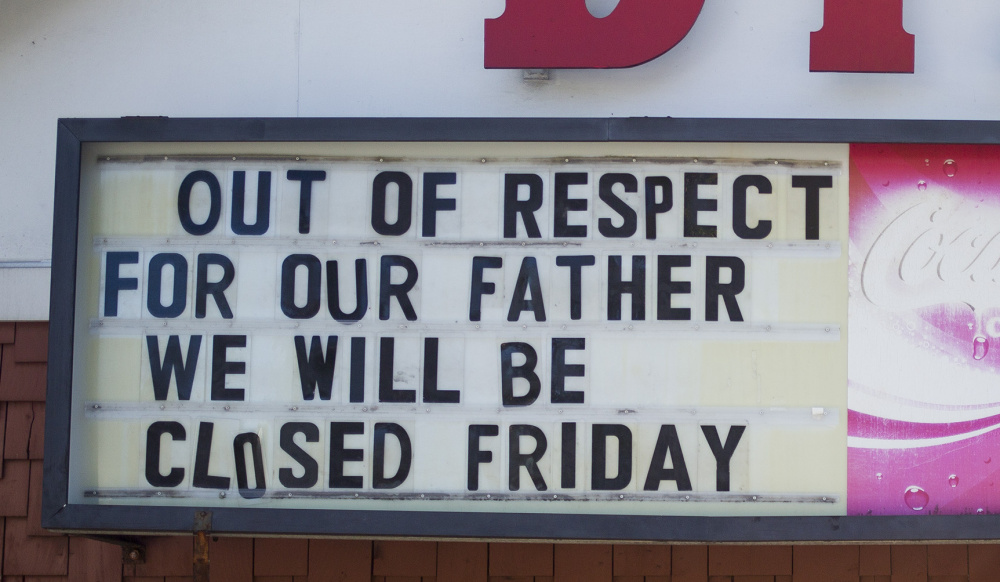 """The sign outside DiPietro's Market lets customers know that the store will be closed for Santo """"Sam"""" DiPierto's funeral on Friday."""