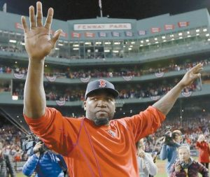 BOSTON'S David Ortiz waves from the field at Fenway Park after Game 3 of baseball's American League Division Series against the Cleveland Indians on Monday.