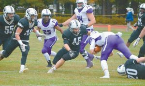 BOWDOIN COLLEGE TACKLERS Henry Little (20) and Tyler MacNeil (45) bring down Amherst wide receiver Nick Widen in the second quarter on Saturday at Whittier Field. Closing in for the Polar Bears are Matthew Whalen (16) and Joe Gowetski (55), while Lord Jeffs player Hasani Figueroa (25) looks on. Amherst dropped Bowdoin to 0-2 with a 31-10 win.
