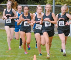 RUNNERS FROM MT. ARARAT, Brunswick and Morse high schools competed in a Kennebec Valley Athletic Conference meet in Topsham on Friday. In the photos, clockwise from the top of the page, from left to right, Brunswick's Desiree Tanner, Allie Burns, Elina Woolever, Emma Slocum and Kirah Despre-Bowman run in the early stages of the girls 5K run, Morse's Ben Willertz (577) and Alex Hicks (575) near the end; Shipbuilder Lorelei Pryor (570) and Dragon Kathleen Koval (602) are shoulder to shoulder; girls winner Katherine Leckbee of Mt. Ararat has a comfortable lead, and Eagle Eagan Eldridge pushes toward a win in the boys competition. Turn to B4 to see the meet results.