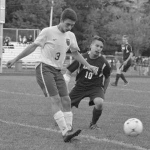 MT. ARARAT'S Dalton Streeter (3) sends a pass forward with Hampden Academy's Alex Ross (10) closing in. The Eagles improved to 9-1 with a 4-0 KVAC victory over the Broncos on Tuesday in Topsham.