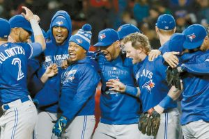 THE TORONTO BLUE JAYS celebrate after clinching a wildcard playoff spot by defeating the Boston Red Sox, 2-1 during a baseball game in Boston on Sunday. The Blue Jays open the 2016 postseason at home tonight against the Baltimore Orioles.