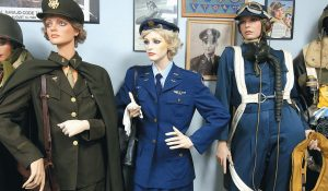 MARY BEECHEM'S Women Airforce Service Pilots World War II uniform, center, and flight suit, right, are displayed at the GI Museum in Ocean Springs, near Gautier, Mississippi. The museum, with all its many donated and collected military history items, has become noted for its women's collection.