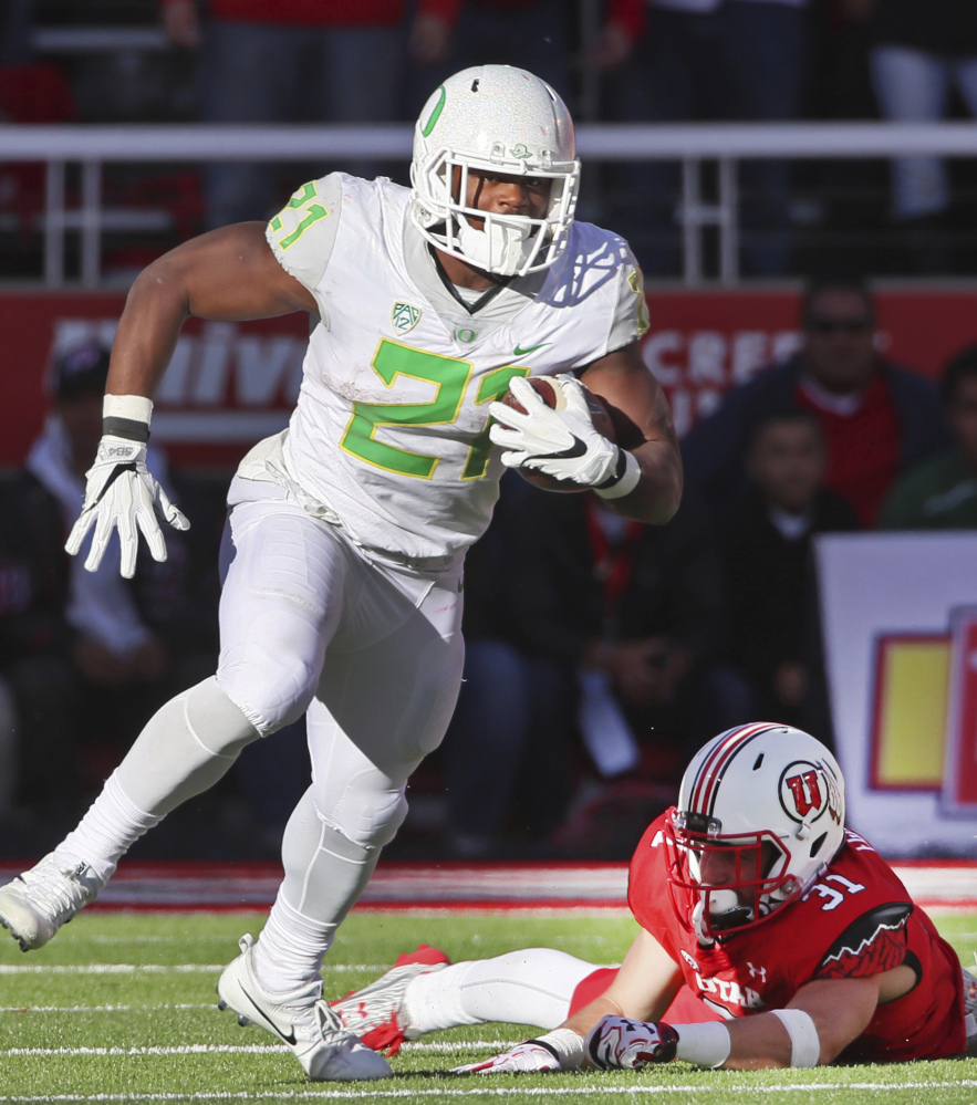 Oregon running back Royce Freeman slips away from Utah linebacker Evan Eggiman during the second half of Oregon's 30-28 upset against the 11th-ranked Utes.