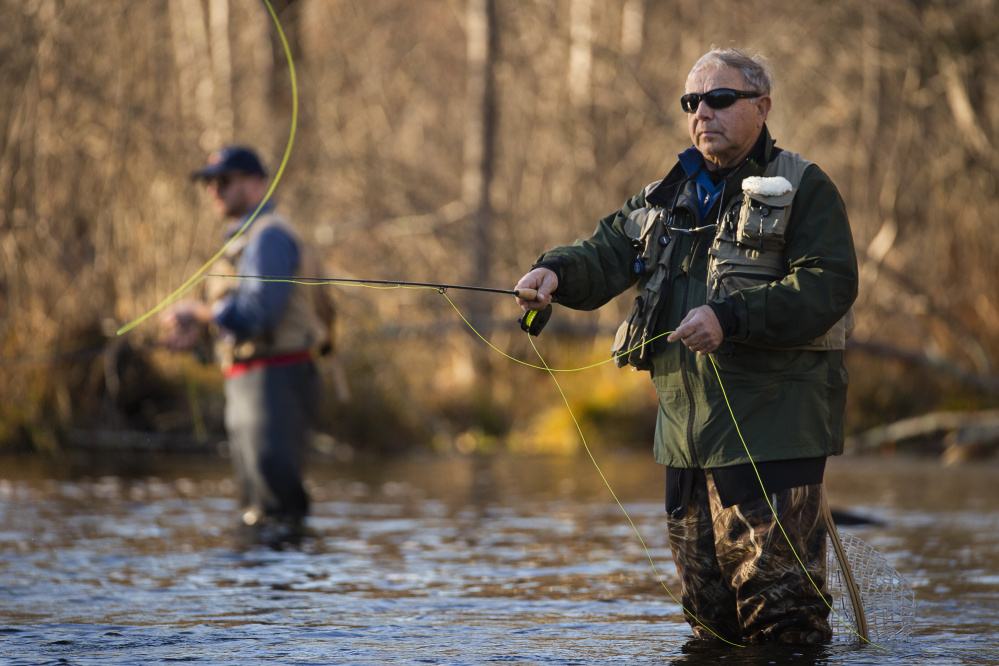Loyd Martin of Raymond fly fishes for trout and salmon on the Presumpscot River in Windham on Nov. 17. Sappi North America has agreed to remove a dam and install a fish passage where the river runs through downtown Westbrook.