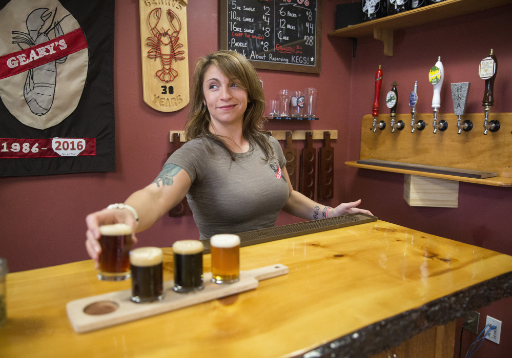 Danielle Coons, tasting room ambassador at Geary's, pours a beer brewed using the small-batch pilot brewing system.