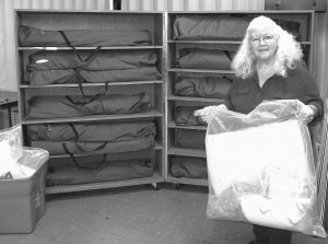 JUDI JOY, shelter manager at the Good Samaritan Haven, shows cots and linens to be used at an overflow seasonal shelter for men that opened in a church in Barre, Vermont. Vermont continues to make investments in emergency community housing for the homeless.